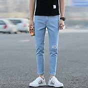 新しい春と夏の膝の穴のジーンズ男性の足のストレッチパンツは乞食スリム韓流パンスト