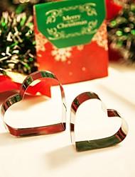 o presente do Natal do coração deu forma cortadores de biscoito