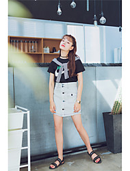 signe minimaliste décoration de fil ouverte rétro minces jupes en denim single-breasted une jupe mot