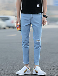 New spring and summer knee hole jeans male feet stretch pants pantyhose beggars Slim Korean wave