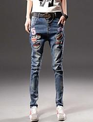 Neue Frühlingsjeans elastische dünne Jeans tragen weiße Abzeichen Füße lange Hosen Harem Hosen Frauen