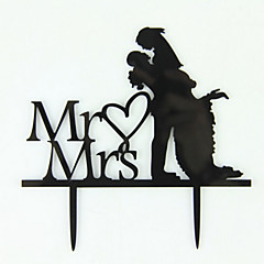 The Groom Holding  Bride Cake Topper